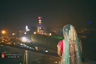 Hair style adorned with gajra sheer bridal dupatta