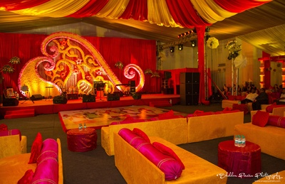 Shamiana setting for evening wedding function with hot pink bolster covers