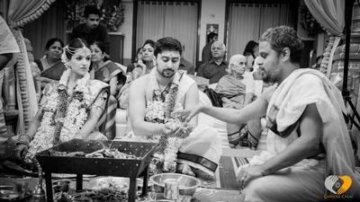 Couple performing the wedding ritual
