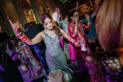 bride having a gala time at the reception