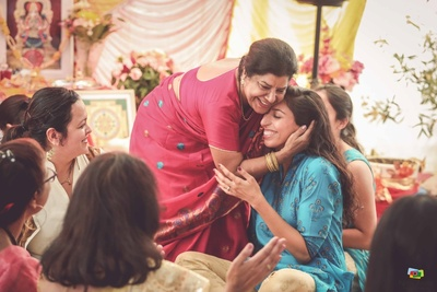 Candid moment between the bride and her mother during the haldi ceremony