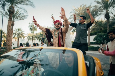 Groom making a grand entry in his car