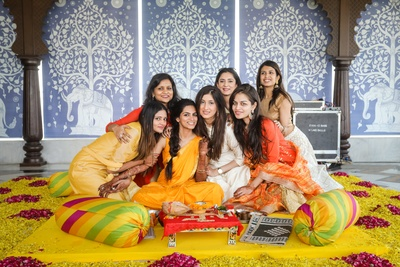 The bride having a good time with her bridesmaids at her haldi ceremony!