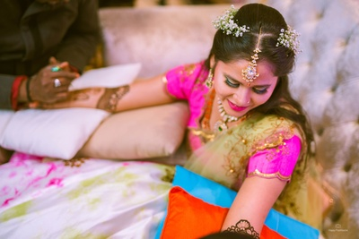 The bride is all smiles during her mehendi ceremony!