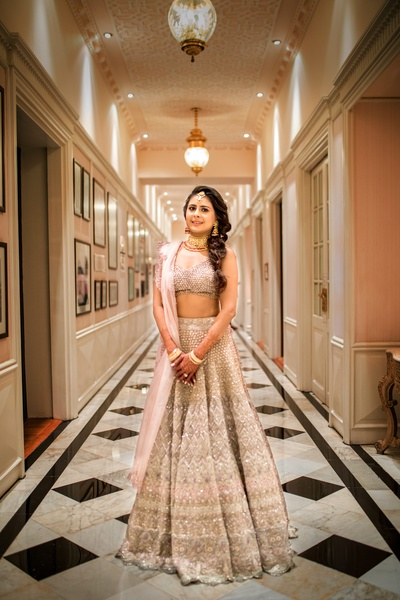 Rhea looking absolutely stunning in an ivory, grey and pink  lehenga for her Mehendi ceremony.