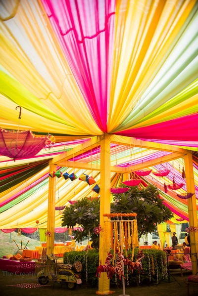 Mehendi function decor with bright Colourful Draps umbrella and scooter