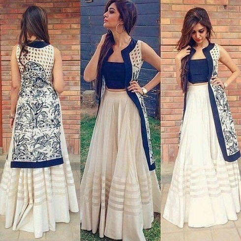 https://media.weddingz.in/images/84c72b2992e3dda529eeee8f555ee428/cool-ways-to-use-crop-tops-as-lehenga-blouses-for-indian-wedding-10.jpg