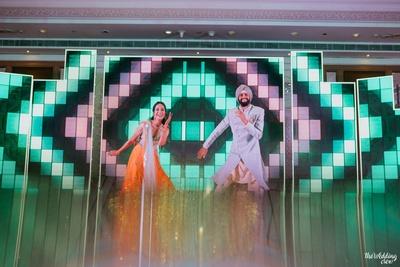 bride and groom sangeet dance performance