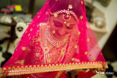 Pink bridal dupatta embellished with sequins, thread work and beads by ace designer Sabyasachi Mukherjee