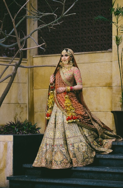 A perfect click of the bride posing in her offbeat lehenga with unconventional patterns and embroidery
