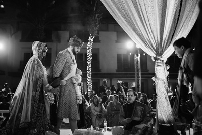 Bride and groom taking the holy saath pheras