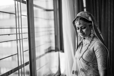 Beautiful bride posing in her wedding lehenga