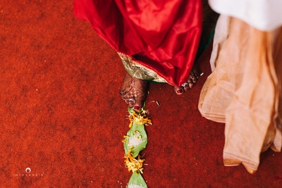 Wedding rituals shot brilliantly by Into Candid Photography.