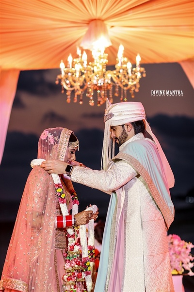 A candid picture of the couple during the jaimala