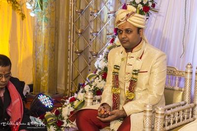 Cream Wedding Sherwani with self print designs for groom