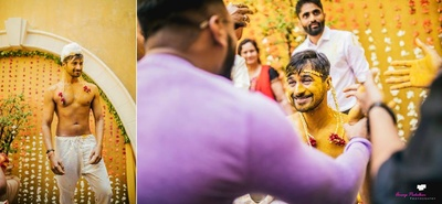 The groom getting smeared in haldi
