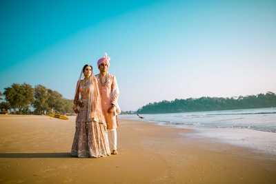 The Bride and Groom pose for The Photo Diary at the beach for couple portraits