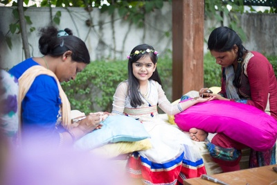 Children at the mehndi function getting their hands henna'd!