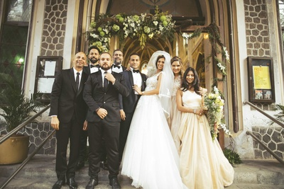 The couple with the bridesmaids and groomsmen after their wedding