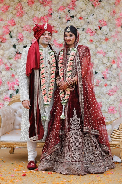 The bride and groom look ethereal in beautiful outfits against a pretty baackdrops.
