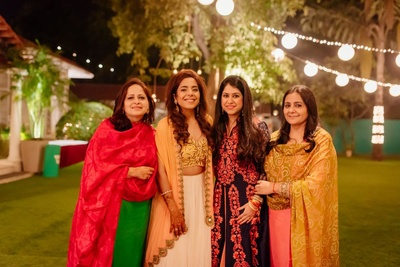 Beautiful bride poses with her family at the function
