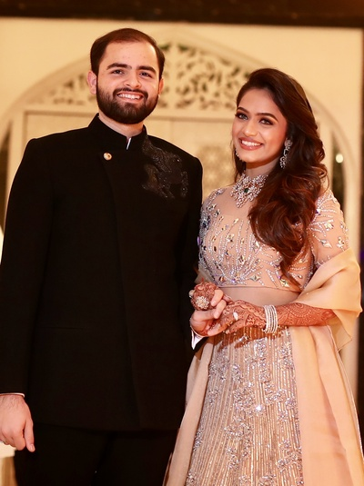 The bride and groom in contrasting outfits for their sangeet