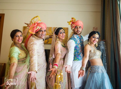Quirky picture of the bride with her family