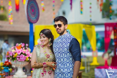 Ayesha and Arjun in a candid moment at their mehndi ceremony