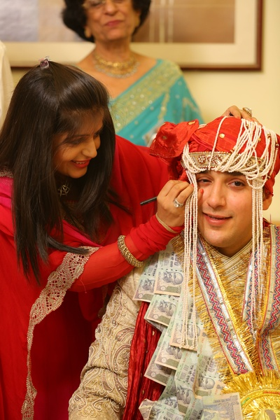 Groom wearing a currency garland