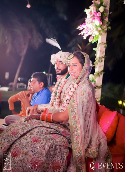 Quirky bride and groom candid shot at the wedding mandap