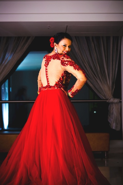 Flared floor length gown with skin colored embroidered bodice adorned with rose flowers