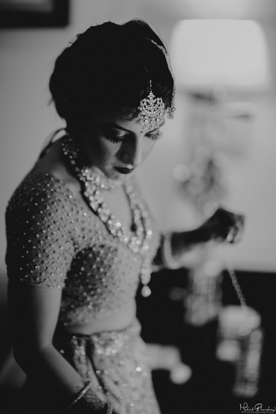 Candid shot of bride while getting ready for her wedding ceremony