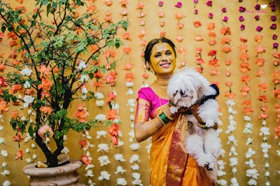 The bride posing with her pet