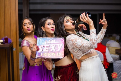 Bride posing with her friends during the sangeet