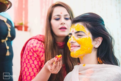 The beautiful bride is all blushes during her haldi ceremony!