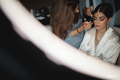 Thhe bride getting all ready and dressed for her wedding ceremony.