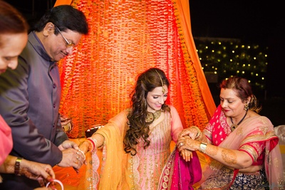 Chooda ceremony during the mehndi function at Amer Greens, Bhopal