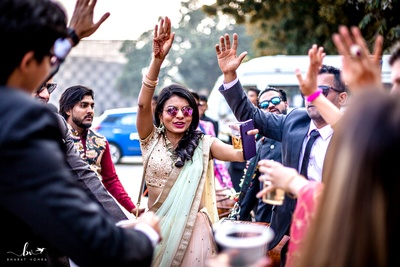 Guests having a gala time dancing at the baraat.