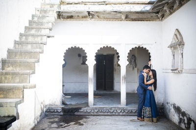 Wearing color coordinated outfits for their pre-wedding shoot held at Chunda palace, Udaipur.