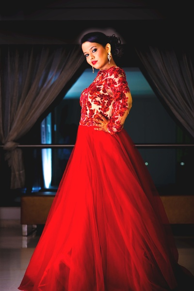 Blood red floor length netted gown with embroidered bodice