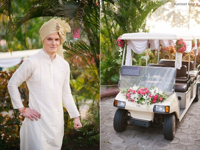 The wedding buggy decorated with drapes and clustered floral arrangement