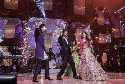 Tanya and Azhar shaking a leg with the King Khan!
