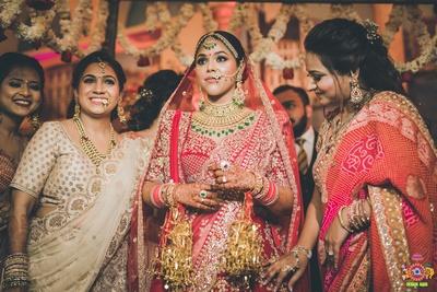 bridal entry under a beautiful floral chaddar