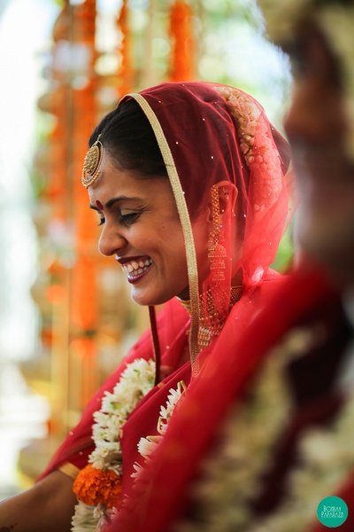 Candid shot captured of a beautiful bride who is all smiles and laughter