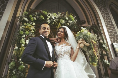 A beautiful picture of the couple against a floral backdrop