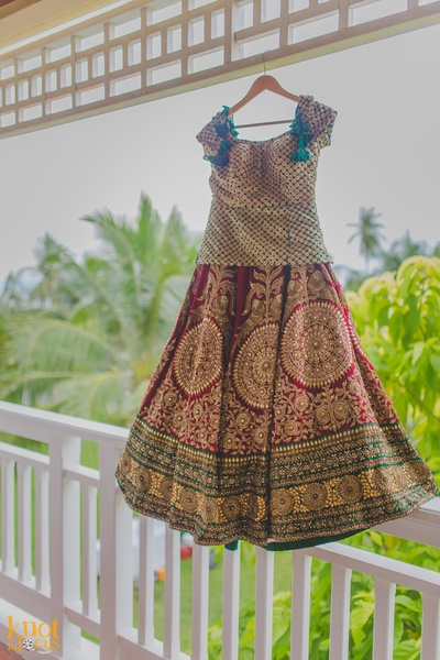Green and red wedding lehenga embellished with gold sequins, motifs and thread work by Tarun Tahiliani