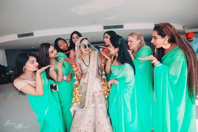 Bride and bridesmaids in a quirky pre wedding pose