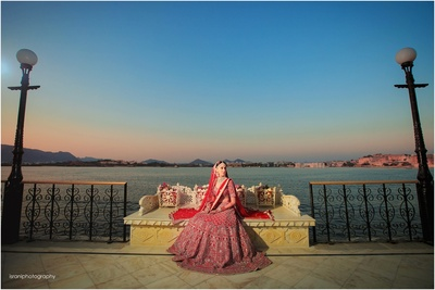 The stunning bride in a Ruby Red lehenga by Anita Dongre for her wedding