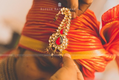 Orange and gold stripped organza adorned with ornamented Kalgi