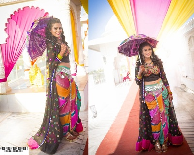 Rajasthani inspired modern mehendi outfit styled with a long black mirror worked cap